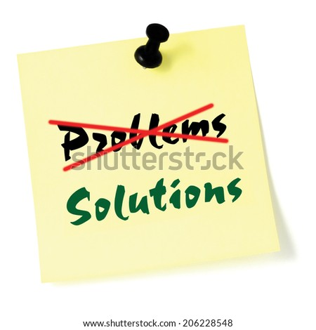 Crossing out problems, writing solutions sticky note, yellow isolated sticker, green text, black thumbtack pushpin, problem solving concept - stock photo