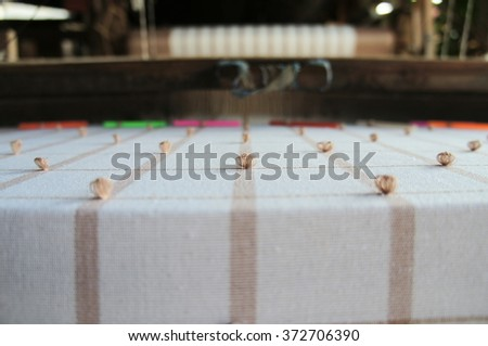 Crossing threads over and under - stock photo
