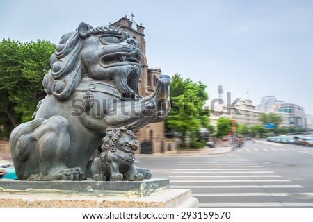 crossroad and the copper lion statue in tianjin , China - stock photo