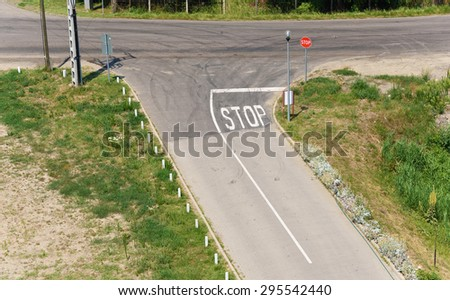 Crossroads in country with stop sign - stock photo