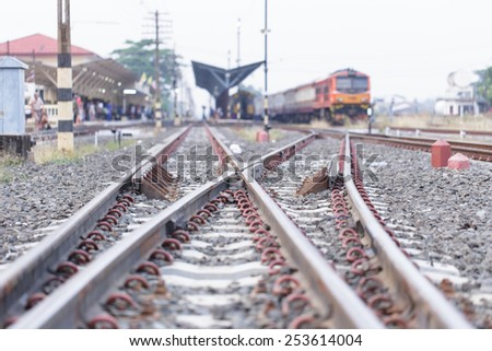 Crossroads of the train and blurred train in station - stock photo