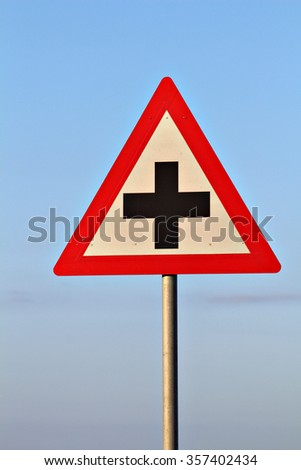 Crossroads sign: A road sign warns of an intersection ahead. - stock photo
