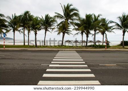 Crosswalk across the street on the seafront in Danang, Vietnam - stock photo