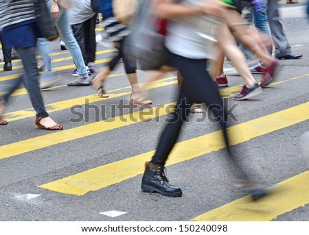 crosswalk and pedestrian at street in hong kong  - stock photo