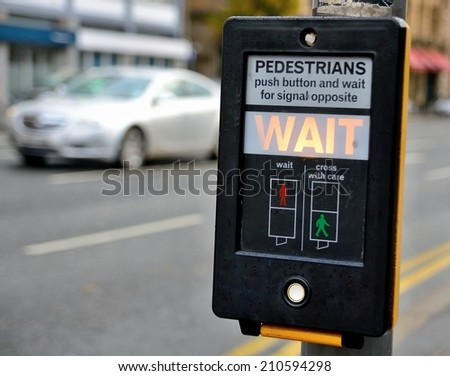Crosswalk button for pedestrian with light warning. - stock photo