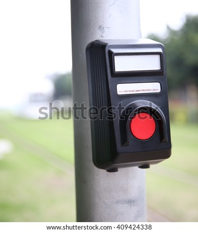 Crosswalk pedestrian signal button and sign to switch traffic  - stock photo