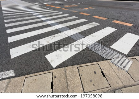 Crosswalk with sign line blind people, Japan - stock photo