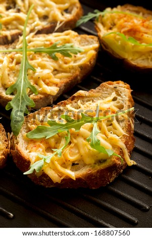 Crostini with cheese and herbs - stock photo