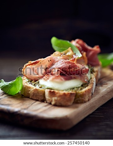 Crostini with cured ham and mozzarella - stock photo