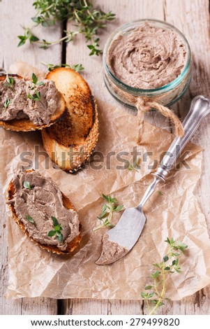 Crostini with liver pate - stock photo