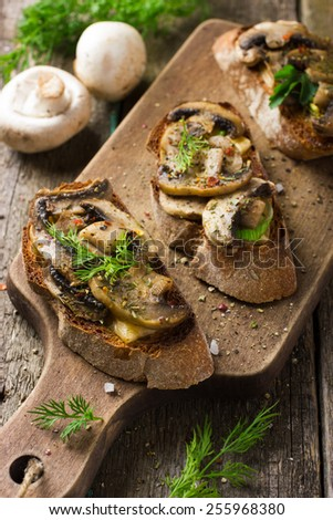 Crostini with mushrooms and cheese - stock photo