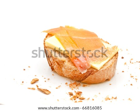 Crostini with smoked salmon and butter - stock photo