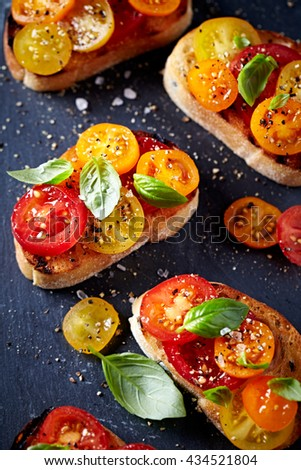 Crostinis with Fresh Cherry Tomatoes and Basil - stock photo