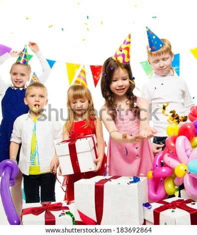 Croup of happy children celebrating birthday