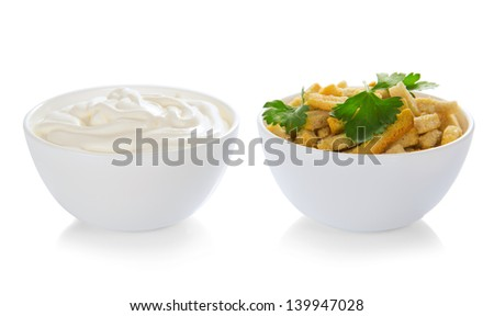 Croutons and bowl with the sour cream, isolated on white - stock photo