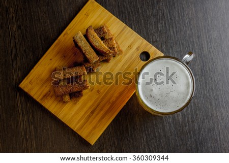 croutons with beer view from above - stock photo