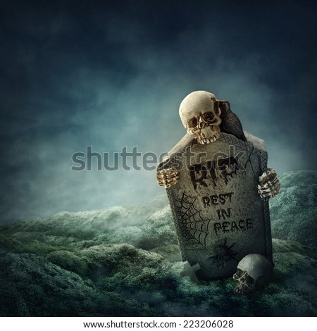Crow sitting on a gravestone at night - stock photo
