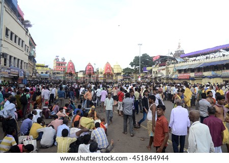 Crowd and devotees gathers in front of Puri temple where three Rath or car are stand for the procession during the Ratha Yatra Festival on July 06, 2016 in Puri, Orissa.