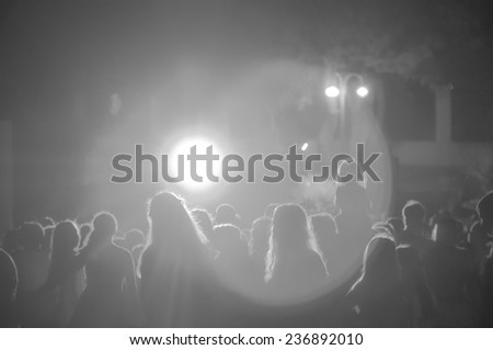crowd at a concert in black and white light - stock photo