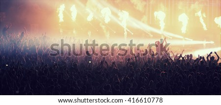 Crowd at concert and blurred  colorful stage lights