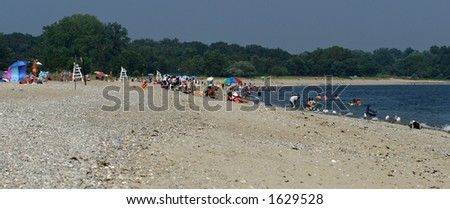 Crowd at the Beach - stock photo