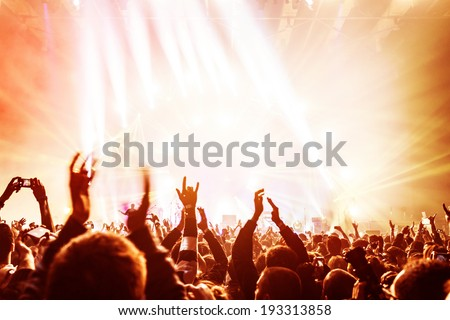 Crowd enjoying concert, happy people jumping, large group celebrating new year holiday, party background fun concept  - stock photo