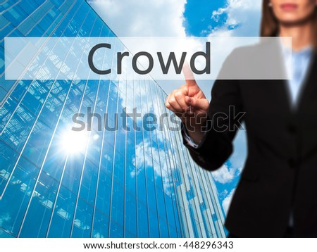 Crowd -  Female touching virtual button. Business, internet concept. Stock Photo