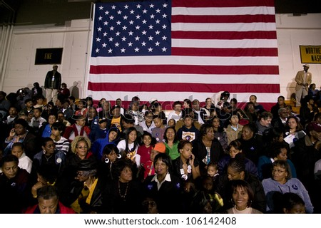 Crowd in front of American flag during Barack Obama Presidential Rally, October 29, 2008 in Rocky Mount High School, North Carolina - stock photo