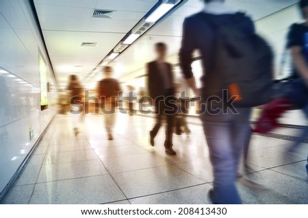 Crowd inside subway train station in motion blur abstract effect