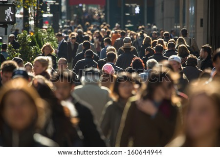 Crowd of anonymous people walking on busy New York City street - stock photo