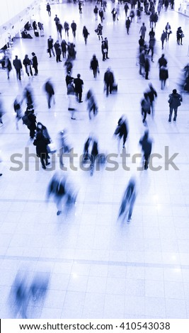 Crowd of commuters in motion blur - stock photo