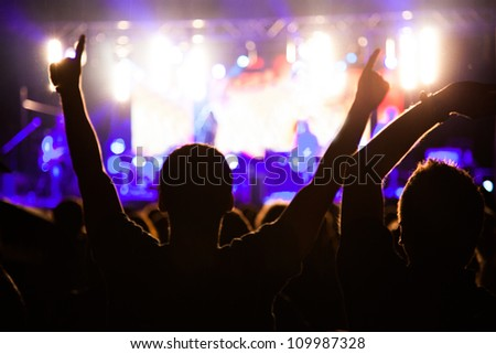 Crowd of fans at night concert - stock photo