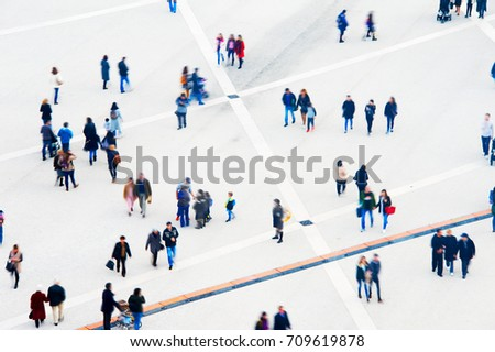 Crowd of people at a public square. Long exposure. Motion blur. Aerial view