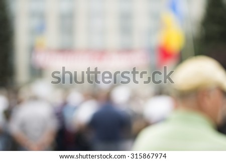 Crowd of people bokeh background.Protest concept. - stock photo