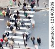 crowd of people crossing the street on the zebra crossing - stock photo