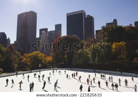 Crowd of people ice skating in urban skating rink - stock photo