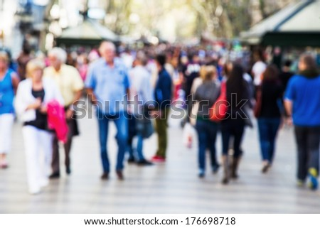 crowd of people out of focus on a strolling promenade - stock photo