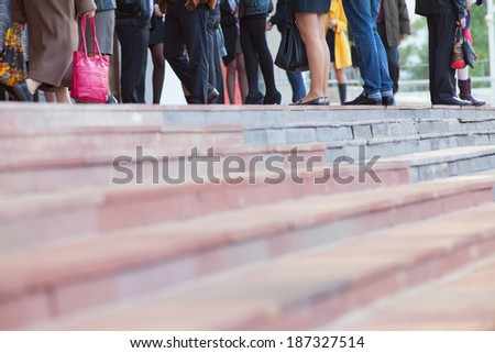 Crowd of people walking on stairs on a city street