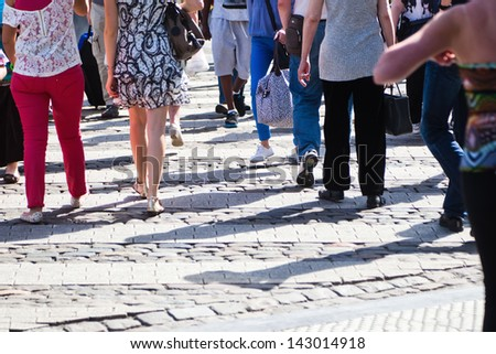 crowd of unrecognizable people walking on the shopping road - stock photo