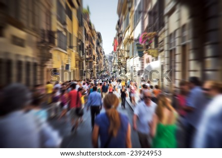 Crowd on a narrow Italian street. Motion blur effect. - stock photo