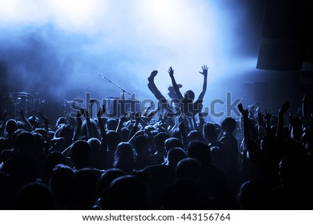 Crowd surfing during a musical performance