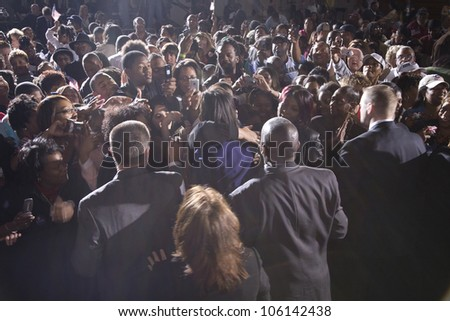 Crowd watching Michelle Obama during Barack Obama Presidential Rally, October 29, 2008 in Rocky Mount High School, North Carolina - stock photo