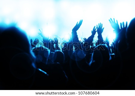 Crowd waving hands and sheering at the music concert - stock photo