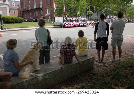 Crowd with dog watches veterans ceremony on Memorial Day, 2011, Concord, MA - stock photo