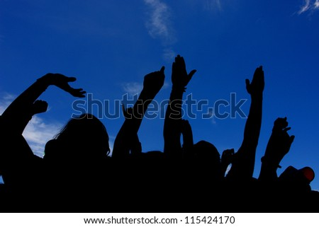 crowd with raised hands - stock photo