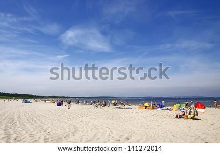 Crowded Baltic summer beach in Swinoujscie, Poland - stock photo