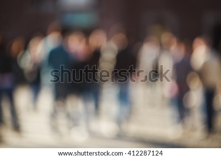 Crowded blurred street in Milan, Italy. Blurred people background. - stock photo