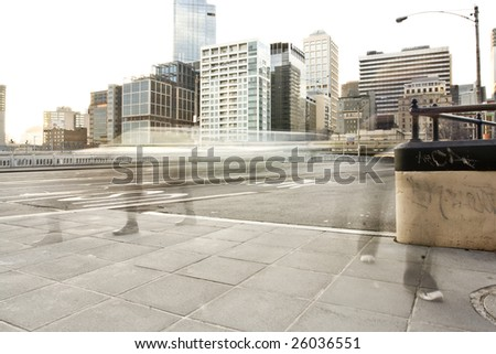 Crowded business people walking in the city - stock photo