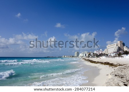 Crowded hotel zone along Caribbean sea coast, always warm and sunny Cancun, Mexico - stock photo