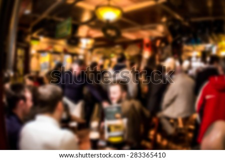 Crowded Irish pub blur - stock photo